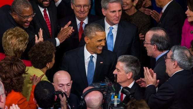 President Obama greets members of Congress before delivering his State of the Union Address on Jan. 20, 2015.