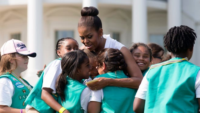 First Lady Michelle Obama hugs Girl Scouts while hosting the first-ever White House Campout at the White House on June 30. The same day, the Girl Scouts of Western Washington raised more than $200,000 after rejecting a $100,000 donation that said the money could not support transgender girls.