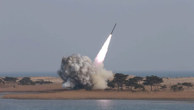 The North Korean news agency KCNA shows the test-firing of new-type large-caliber multiple launch rocket system by the North Korean military in an undated handout made available on March 4, 2016.