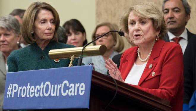 Rep. Louise Slaughter, D-N.Y., speaks beside House Minority Leader Nancy Pelosi, D-Calif., at a news conference on Capitol Hill on Jan. 5, 2017.