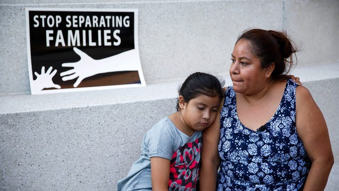 Undocumented immigrant Isabel Sandoval and her daughter Marisol react after the US Supreme Court issued a split ruling on President Obama's Immigration Policy during a vigil in Los Angeles, on June 23, 2016. The ruling presents a challenge to President Barack Obama's Deferred Action for Parents of Americans and Lawful Permanent Residents (DAPA) and Deferred Action for Childhood Arrivals (DACA) programs.
