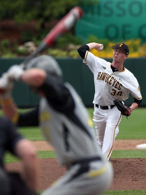 The Iowa Hawkeyes' Tyler Peyton pitches against the Oregon Ducks during NCAA Regional Baseball action from Hammons Field in Springfield, Missouri on May 29, 2015