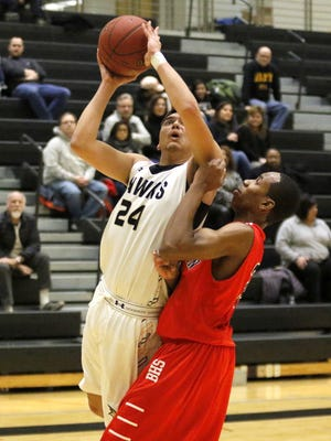 Jason Rodriguez puts up a shot for Corning as Yachezqel Ogbonna defends for Binghamton on Jan. 24 at Corning-Painted Post High School.
