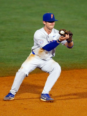 Florida shortstop Deacon Liput fields a ground ball against LSU during the Southeastern Conference tournament.