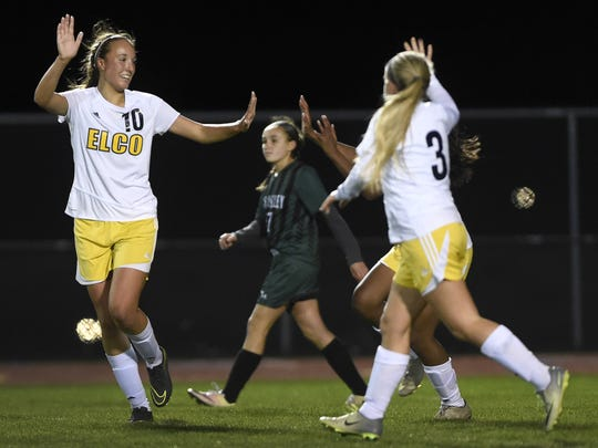 Ryelle Shuey, left, celebrates a goal during last season's district playoff win over Twin Valley.