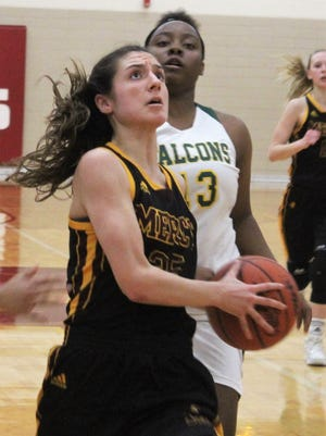 Mercy senior Bella Dugas (35), who netted a team-high 21 points, drives past Groves defender Kayla Taylor (13) in the fourth quarter of Monday's Class A district opener.