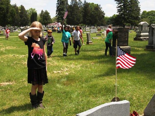 Pataskala Elementary third-grader Chloe Brown salutes