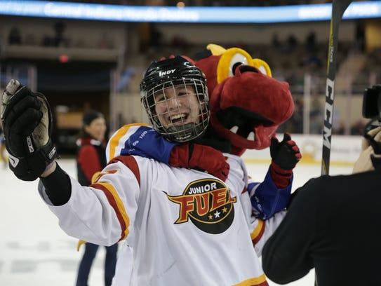 Nitro grabs Mac Perkins with joy after the youth hockey