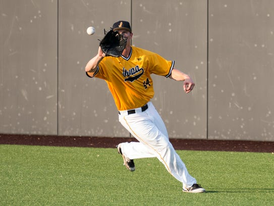 Iowa outfielder Robert Neustrom gets an out during