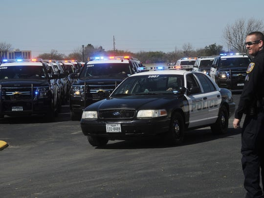 APD Sgt. Richie Waggoner directs the procession after