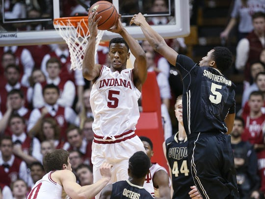 Indiana Hoosiers forward Troy Williams gets up to get a rebound over Purdue Boilermakers forward Basil Smotherman in the second half. Indiana hosted Purdue at Assembly Hall on Thursday, February 19, 2015.