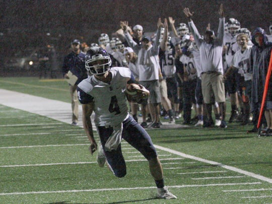 Lakota's Tyler Gabel rushes for one of two touchdowns Saturday against Calvert. He added two touchdown throws.