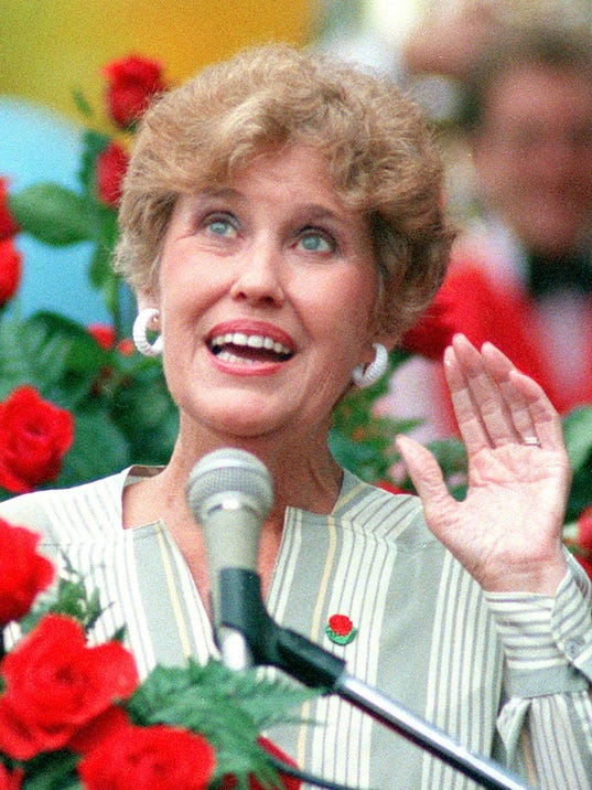 Text: FILE - Erma Bombeck, the late humor columnist who poked fun at everyday life and gave voice to suburban housewives, is shown surrounded by roses at a news conference in this Sept.1985 photo. Bombeck's writings, were presented to her alma mater, the University of Dayton, Friday, March 31, 2000, to be preserved in the school's archives. (AP Photo/Lacy Atkins, File)