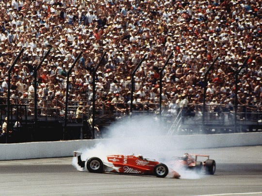 Danny Sullivan, who passed leader Mario Andretti, spins