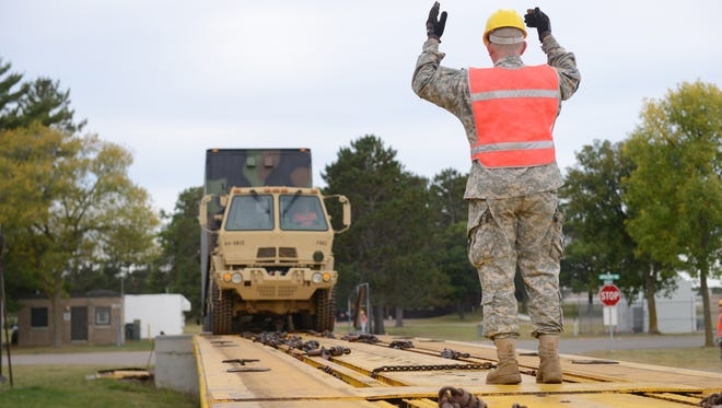 Members of the Minnesota National Guard will load vehicles and equipment onto rail cars at Camp Ripley for movement to a training site in California.