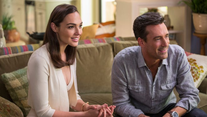 """New neighbors Tim and Natalie (Gal Gadot and Jon Hamm) have a secret in """"Keeping Up with the Joneses."""""""