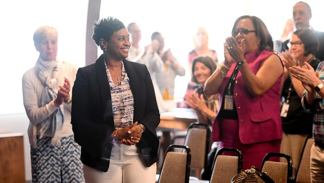 Denise Patterson receives a standing ovation from the crowd after being named the new superintendent of Asheville City Schools during a special school board meeting on Thursday, June 1, 2017.