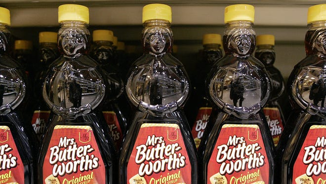 Bottles of Pinnacle Foods' Mrs. Butterworth's Original Syrup are displayed in a store, in Princeton, N.J. on Nov. 24, 2015.