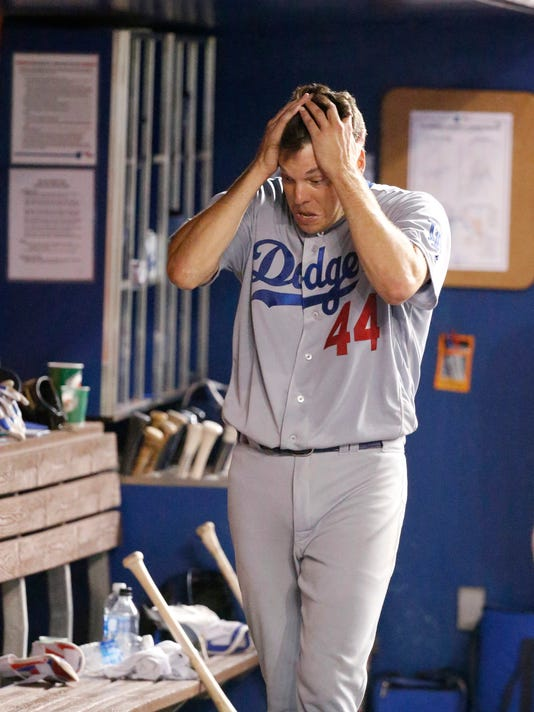 Los Angeles Dodgers starting pitcher Rich Hill runs his hands through his hair after being pulled during the eighth inning of a baseball game against the Miami Marlins, Saturday, Sept. 10, 2016, in Miami. (AP Photo/Wilfredo Lee)