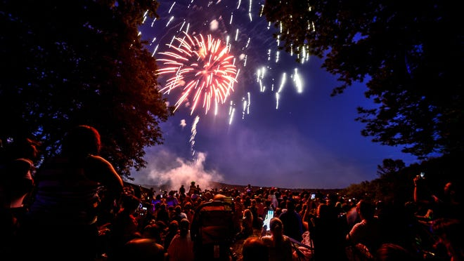 Families and friends gather on a hill at Highland Park in Endwell to watch the annual Fourth of July fireworks.
