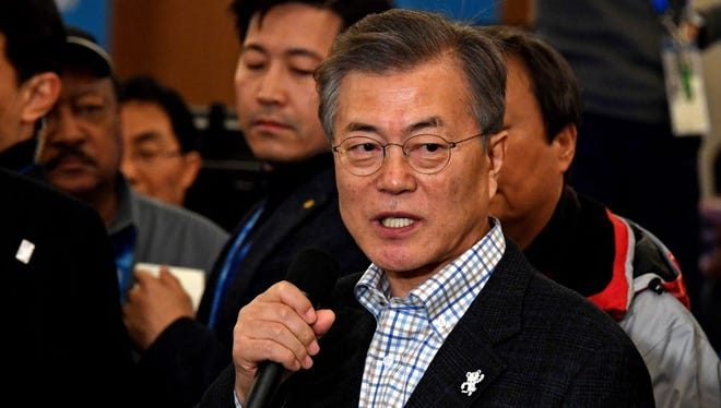 South Korea president Jae-in Moon visited the Olympic Main Press Center. He told reporters that it's still too early to commit to talks with North Korea.
