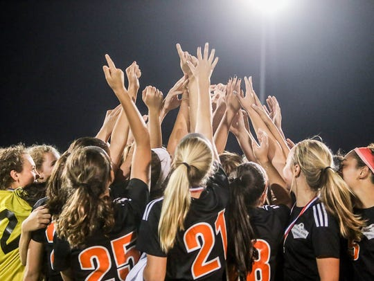 Central York players huddle up and raise their hands