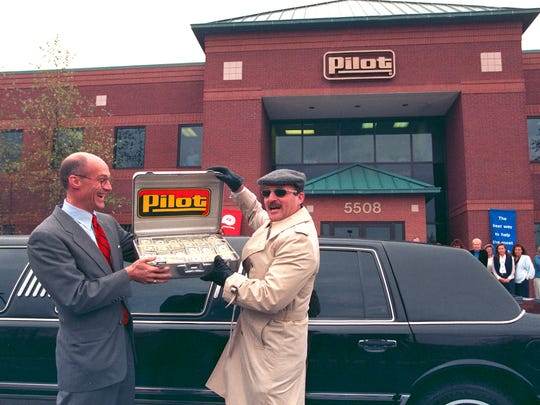 United Way campaign chairman Bill Baxter, left, accepts a $35,675 contribution to the fund drive from Pilot Corp. CFO Jeff Cornish on Nov. 6, 1997, at Pilot headquarters. The money is the proceeds from a three-day Celebrity Pumpers fundraiser co-sponsored by Pilot and the News-Sentinel.