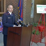 Major Bob Mueller, coordinator of The Salvation Army of Brown County, kicks off the agency's fourth annual Christmas in July Campaign outside The Salvation Army Corps Community Center in Green Bay on Wednesday. The five-day campaign starts Thursday with a fundraising goal of $35,000.