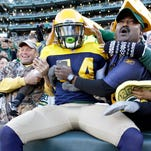 Green Bay Packers running back James Starks (44) celebrates his first touchdown against the San Diego Chargers at Lambeau Field.