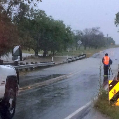 Barricades are up on this flooded stretch of FM 157