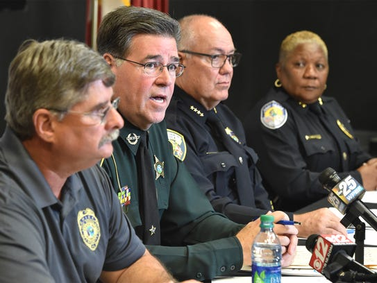 St. Lucie County Sheriff Ken Mascara (second from left)