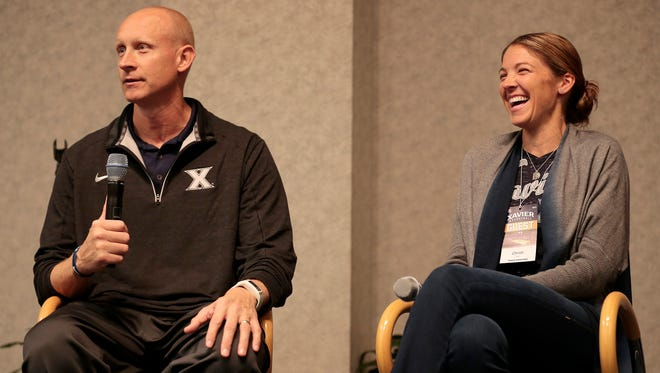 Christi Mack laughs as her husband, Xavier coach Chris Mack, answers a question about their first date in a Q&A session at Basketball 101 for Women, Thursday at Cintas Center.