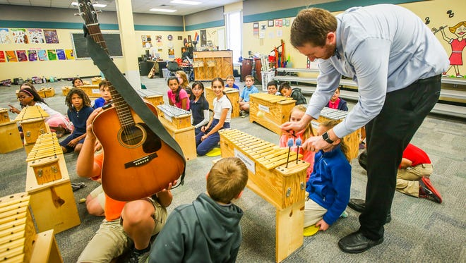 """Music teacher Jason Thomashefsky is one of six winners of The Foundation for Lee County Public Schools' Golden Apple award. """"It's hard to think that what I do is different,"""" Thomashefsky said. """"I try to stay as humble as possible because there are thousands of great and outstanding teachers in Lee County."""""""