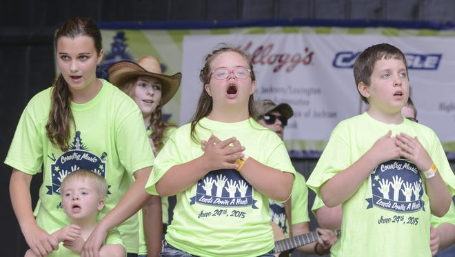 """Kids performed songs such as """"Love Can Build A Bridge"""" and """"Give Thanks"""" in this file photo at the 2015 Down Syndrome Association of West Tennessee's Country Music Lends Down a Hand concert."""