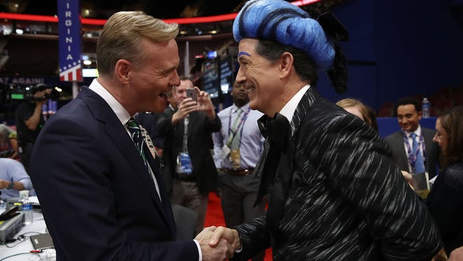 CBS journalist John Dickerson (L) meets comedian Stephen Colbert (R) on the floor of the Republican National Convention for CBS's The Late Show with Stephen Colbert at the Quicken Loans Arena  July 17, 2016 in Cleveland, Ohio.