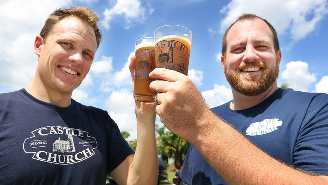 Jared Witt, left, and Aaron Schmalzle, co-founders of Castle Church Brewing Community, hoist some micro-brewed beers outside Schmalzle's Kissimmee, Fla. home. They plan to open a brew pub in downtown Orlando in coalition with their Lutheran faith.