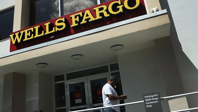File photo taken in 2016 shows the Wells Fargo sign outside a bank branch in Miami, Florida.  Reports indicate that more than 5,000 Wells Fargo employees have been fired as a result of a scandal involving employees that secretly set up new fake bank and credit card accounts in order to meet sales targets.  (Photo by Joe Raedle/Getty Images) ORG XMIT: 668246071 ORIG FILE ID: 601081902