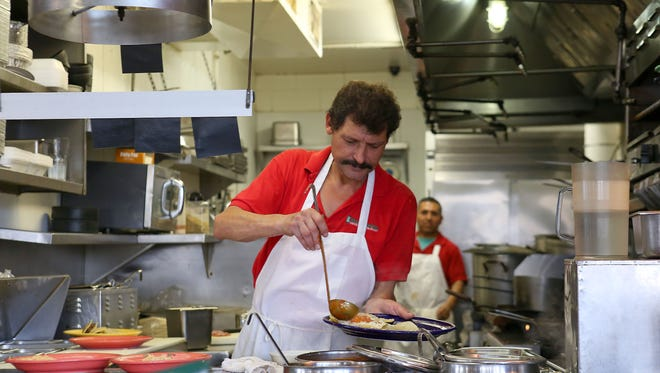 El Rincón Norteño cook Eddie Villarreal prepares breakfast plates in October 2015. Some 55 percent of American workers did not use all of their time off in 2015, according to a report by Project Time Off, which studies labor, vacation and related trends.