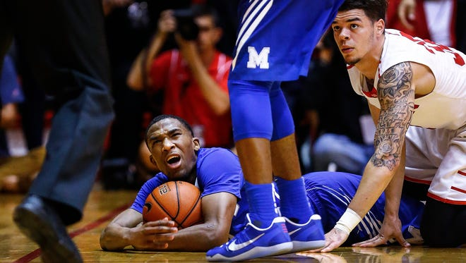 University of Memphis guard Jeremiah Martin (middle) reacts while an official calls him out of bounds after knocking the ball away from University of Houston guard Rob Gray (right) during second half action at the Hofhienz Pavilion in Houston, Texas.