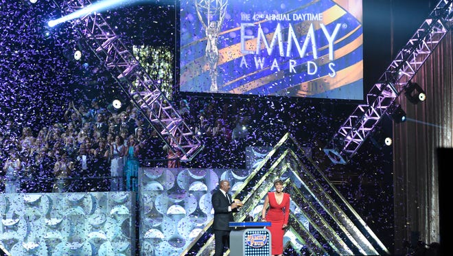 """FILE - In this April 26, 2015 file photo, Steve Harvey, left, and Tyra Banks appear at the 42nd annual Daytime Emmy Awards in Burbank, Calif.  CBS led with 70 nominations overall while its daytime drama """"The Young and the Restless"""" led with 25 nods when nominations were announced Wednesday, March 22, 2017, for the 44th Annual Daytime Emmy awards.  The awards ceremony will air April 30. (Photo by Chris Pizzello/Invision/AP, File)"""