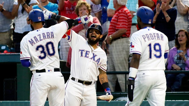 Texas Rangers right fielder Nomar Mazara (30) is greeted by second baseman Rougned Odor (12) after his grand slam home run in the second inning against the Oakland Athletics at Globe Life Park in Arlington.