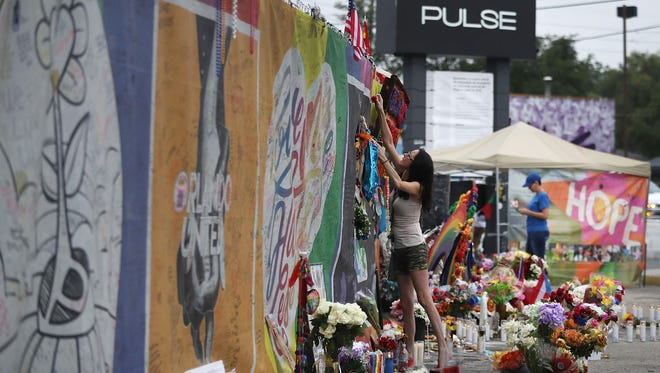 Claudette Mcintosh visits the memorial setup outside the Pulse nightclub on June 12, 2017.