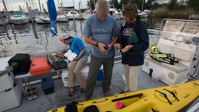 From left, Escambia County environmental team members Mollie Taylor, Dana Morton and Jimmie Jarratt prepare June 27, 2017, to begin mapping the thickness and distribution of the soft sediments in Bayou Chico.