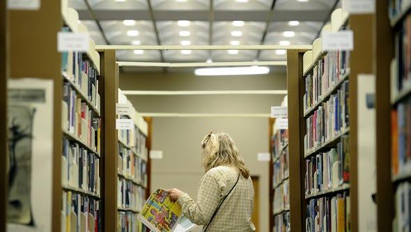 Dr. Stella Richards of Afton peruses the books at Waynesboro