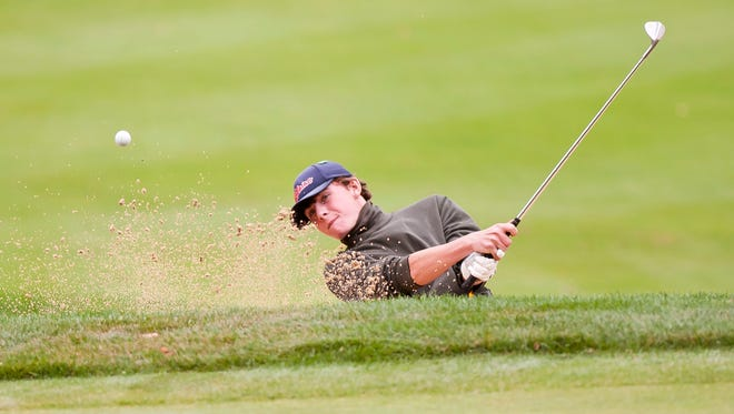 BFA-St. Albans' Robbie Maher blasts out of a bunker on the 15th hole during the Vermont high school boys golf state championships on Wednesday at Green Mountain National Golf Course in Killington.