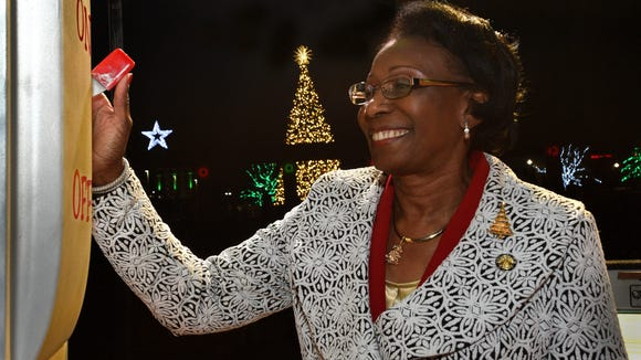 Mayor Ollie Tyler flips the switch to light the Christmas tree Tuesday during the Spirit of the Season celebration held at Shreveport's Riverview Park.