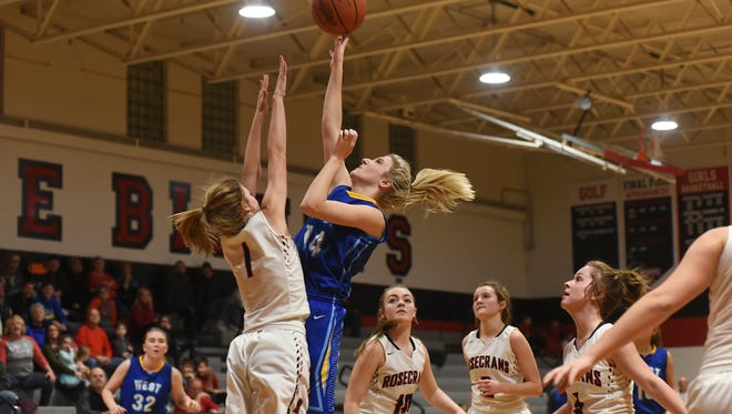 West Muskingum's Hayley Barker puts up a shot over Rosecrans' Sophie Stevens. Barker led the Tornadoes in scoring last season and will anchor the starting five.