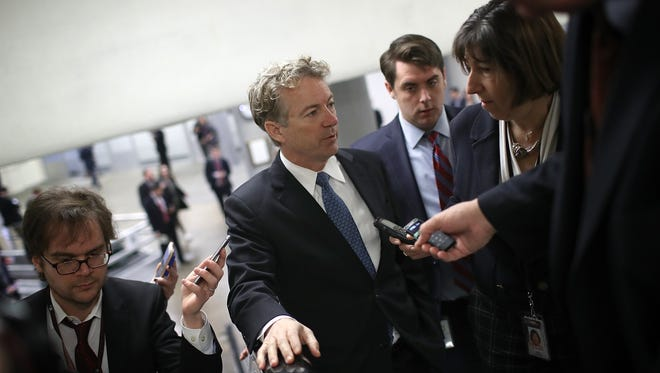 Sen. Rand Paul (R-KY) speaks with reporters on his way to a vote on the floor of the U.S. Senate at the U.S. Capitol February 8, 2018 in Washington, DC. Paul is blocking the U.S. Senate from voting on a spending package reached yesterday to avoid a government shutdown. Paul is demanding that the U.S. Senate vote on an amendment that would cap spending.