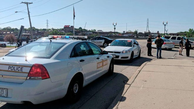 Police cars appear outside Dixon High School on May 16, 2018 in Dixon, Ill. Officials say an officer has shot and wounded a gunman at a northern Illinois high school.