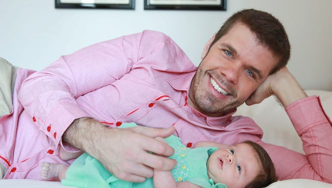 Perez Hilton and his new daughter Mia posing for a portrait at the Sofitel, in New York on June 7, 2015.